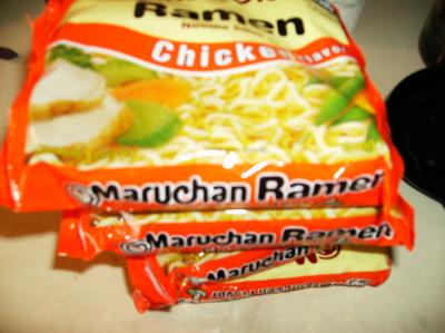 Four chicken ramen packets open